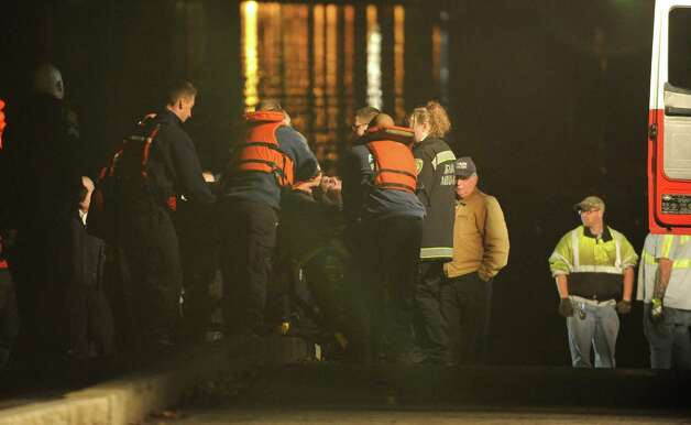 An emergency worker gives CPR to a man in his 80's who drove his car into the Hudson River at the Corning Preserve boat launch on Monday, Nov. 10, 2014 in Albany, N.Y. (Lori Van Buren / Times Union) Photo: Lori Van Buren
