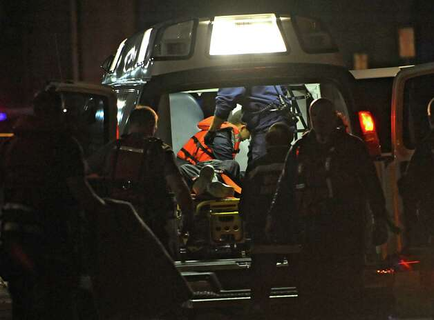 A man in his 80's who drove his car into the Hudson River at the Corning Preserve boat launch is put into an ambulance after being rescued on Monday, Nov. 10, 2014 in Albany, N.Y. (Lori Van Buren / Times Union) Photo: Lori Van Buren