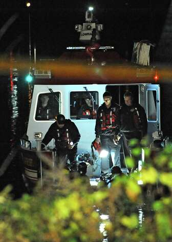 Divers from the Albany Fire Department search for a car that drove into the Hudson River at the Corning Preserve boat launch on Monday, Nov. 10, 2014 in Albany, N.Y. A man in his 80's was found still alive in the car when rescued. (Lori Van Buren / Times Union) Photo: Lori Van Buren
