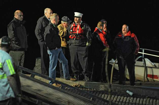 Members of the Albany Fire Department search for a car that drove into the Hudson River at the Corning Preserve boat launch on Monday, Nov. 10, 2014 in Albany, N.Y. A man in his 80's was found still alive in the car when rescued. (Lori Van Buren / Times Union) Photo: Lori Van Buren