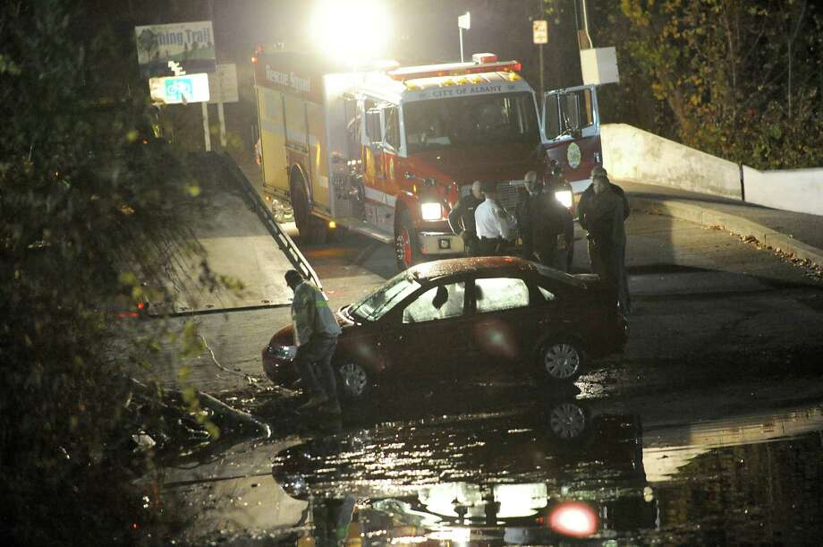The car that drove into the Hudson River at the Corning Preserve boat launch is seen waiting to be pulled up on a tow truck on Monday, Nov. 10, 2014 in Albany, N.Y. A man in his 80's was found still alive in the car when rescued. (Lori Van Buren / Times Union) Photo: Lori Van Buren