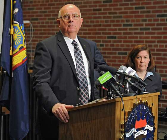 Saratoga County Sheriff Michael Zurlo speaks during a press conference where he announced that the deputy involved in a recent video was charged and arrested and no longer is employed by the Saratoga County Sheriff's Office on Monday, Nov. 10, 2014 in Ballston Spa, N.Y. Saratoga County Acting District Attorney Karen Heggen stands at right. (Lori Van Buren / Times Union) Photo: Lori Van Buren / 00029422A