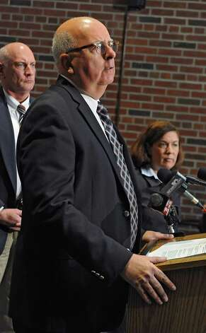 Saratoga County Sheriff Michael Zurlo speaks during a press conference where he announced that the deputy involved in a recent video was charged and arrested and no longer is employed by the Saratoga County Sheriff's Office on Monday, Nov. 10, 2014 in Ballston Spa, N.Y.  Undersheriff Kevin Mullahey, left, and Saratoga County Acting District Attorney Karen Heggen listen behind him. (Lori Van Buren / Times Union) Photo: Lori Van Buren / 00029422A