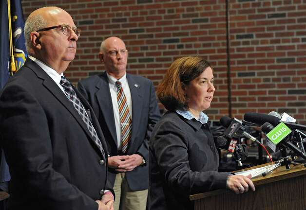 Saratoga County Acting District Attorney Karen Heggen  speaks during a press conference where it was announced that the deputy involved in a recent video was charged and arrested and no longer is employed by the Saratoga County Sheriff's Office on Monday, Nov. 10, 2014 in Ballston Spa, N.Y.Saratoga County Sheriff Michael Zurlo, left, and Undersheriff  Kevin Mullahey listen behind her. (Lori Van Buren / Times Union) Photo: Lori Van Buren / 00029422A