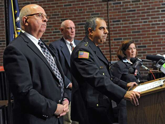 Chief at Saratoga County Sheriff's Office Richard Castle answers questions during a press conference where it was announced that the deputy involved in a recent video was charged and arrested and no longer is employed by the Saratoga County Sheriff's Office on Monday, Nov. 10, 2014 in Ballston Spa, N.Y.Saratoga County Sheriff Michael Zurlo, left, Undersheriff  Kevin Mullahey and Saratoga County Acting District Attorney Karen Heggen, right, listen behind him. (Lori Van Buren / Times Union) Photo: Lori Van Buren / 00029422A