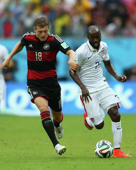 RECIFE, BRAZIL - JUNE 26:  Toni Kroos of Germany challenges DaMarcus Beasley of the United States during the 2014 FIFA World Cup Brazil group G match between the United States and Germany at Arena Pernambuco on June 26, 2014 in Recife, Brazil.  (Photo by Michael Steele/Getty Images) Photo: Michael Steele, Staff / 2014 Getty Images