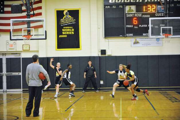 College of Saint Rose players run through drills during basketball practice on Tuesday, Oct. 21, 2014, in Albany, N.Y.  (Paul Buckowski / Times Union) Photo: Paul Buckowski / 00029117A
