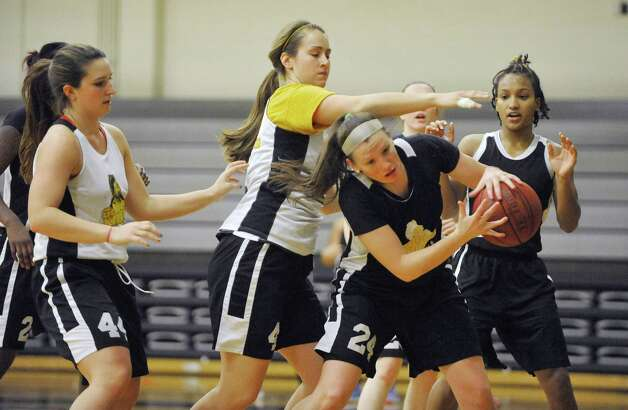 College of Saint Rose player, Kelsey Glanzman, grabs a rebound  during basketball practice on Tuesday, Oct. 21, 2014, in Albany, N.Y.  (Paul Buckowski / Times Union) Photo: Paul Buckowski / 00029117A