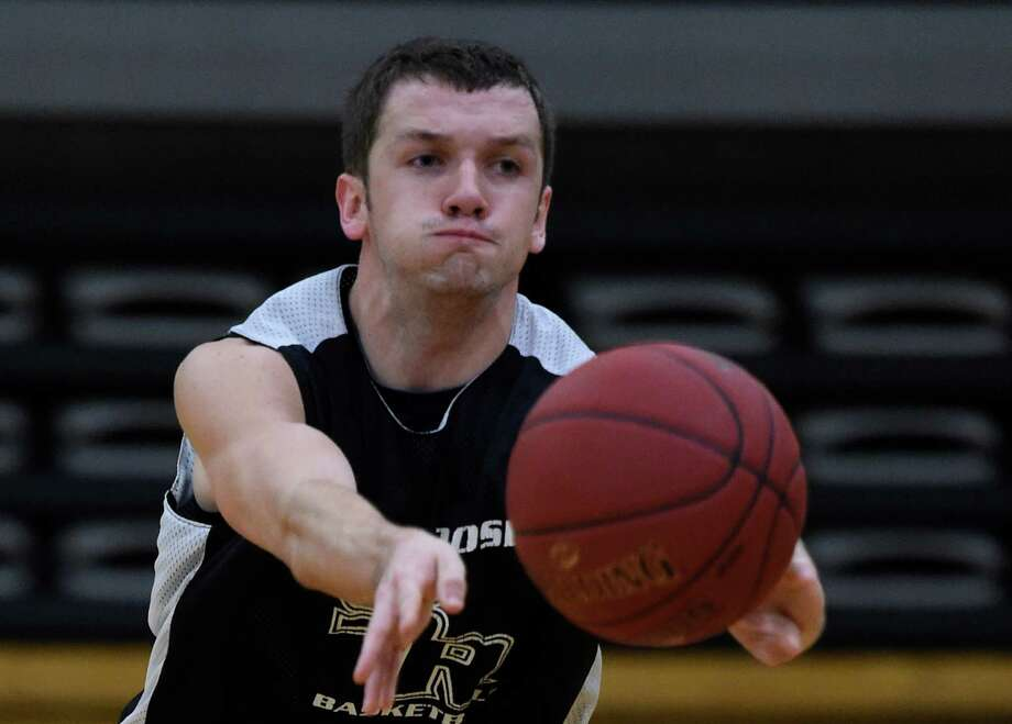 Max Weaver passes the ball during practice Monday morning Nov. 10, 2014 at St. Rose College's gym in Albany, N.Y.       (Skip Dickstein/Times Union) Photo: SKIP DICKSTEIN / 00029413A