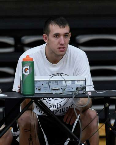 Tyler Sayre works the timer during practice Monday morning Nov. 10, 2014 at St. Rose College's gym in Albany, N.Y.       (Skip Dickstein/Times Union) Photo: SKIP DICKSTEIN / 00029413A