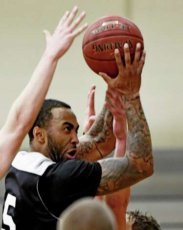 Jalaun Taylor goes for the basket during practice Monday morning Nov. 10, 2014 at St. Rose College's gym in Albany, N.Y.       (Skip Dickstein/Times Union) Photo: SKIP DICKSTEIN / 00029413A