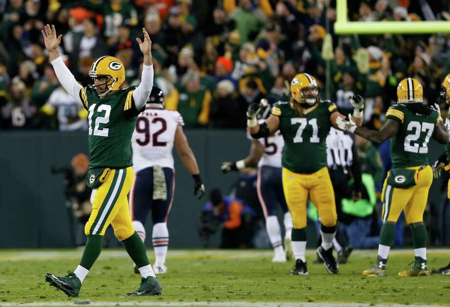 Green Bay Packers quarterback Aaron Rodgers (12) celebrates a touchdown during the first half of an NFL football game against the Chicago Bears Sunday, Nov. 9, 2014, in Green Bay, Wis. (AP Photo/Mike Roemer) Photo: Mike Roemer, FRE / FR155603 AP