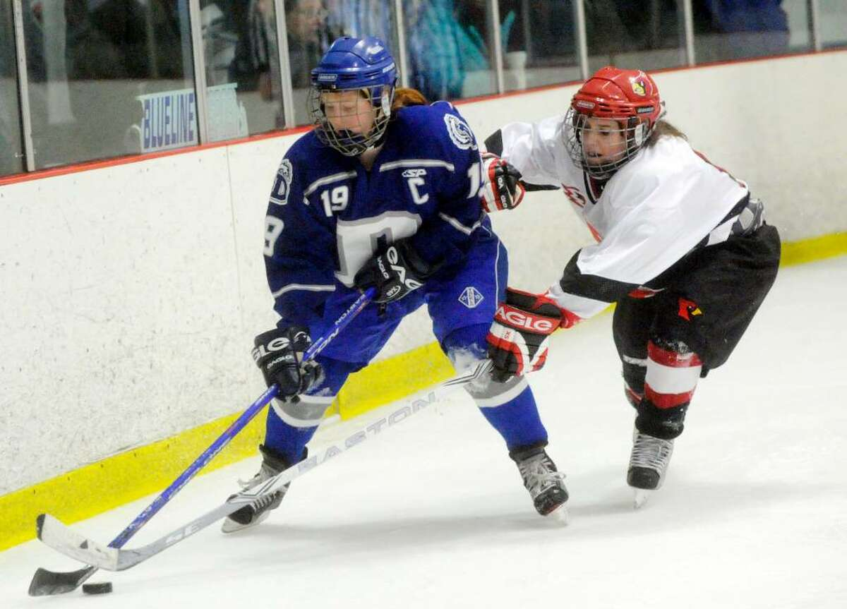 Greenwich's Meghan Spezzano closes in on Darien's Madeline Coburn as Darien hosts Greenwich High in a girls hockey game at the Darien Ice Rink Wednesday evening, Feb. 24, 2010.