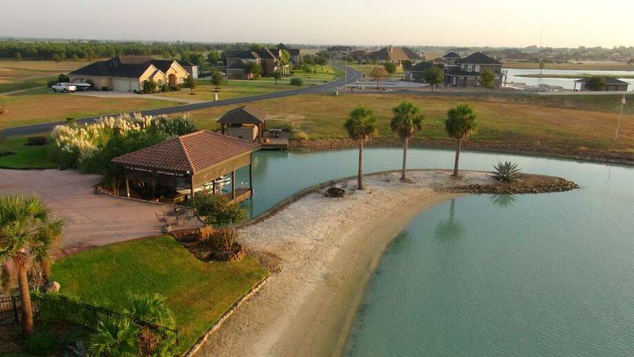 3002 Lakes Of Katy LaneKaty, Texas 77493 This house comes with its own private sand beach, private lagoon, boat deck and rooftop basketball court.  Photo: Houston Association Of Realtors