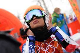 (FILES) A photo taken on February 18, 2014 shows Thailand's Vanessa Vanakorn aka Vanessa Mae before the start of the Women's Alpine Skiing Giant Slalom Run 1 at the Rosa Khutor Alpine Center during the Sochi Winter Olympics. Thai violinist-turned-skier Vanessa Mae has been banned four years over fixing in a Slovenian competition to qualify for the Olympic Games, the International Ski Federation FIS announced on November 11, 2014.  AFP PHOTO / DIMITAR DILKOFFDIMITAR DILKOFF/AFP/Getty Images