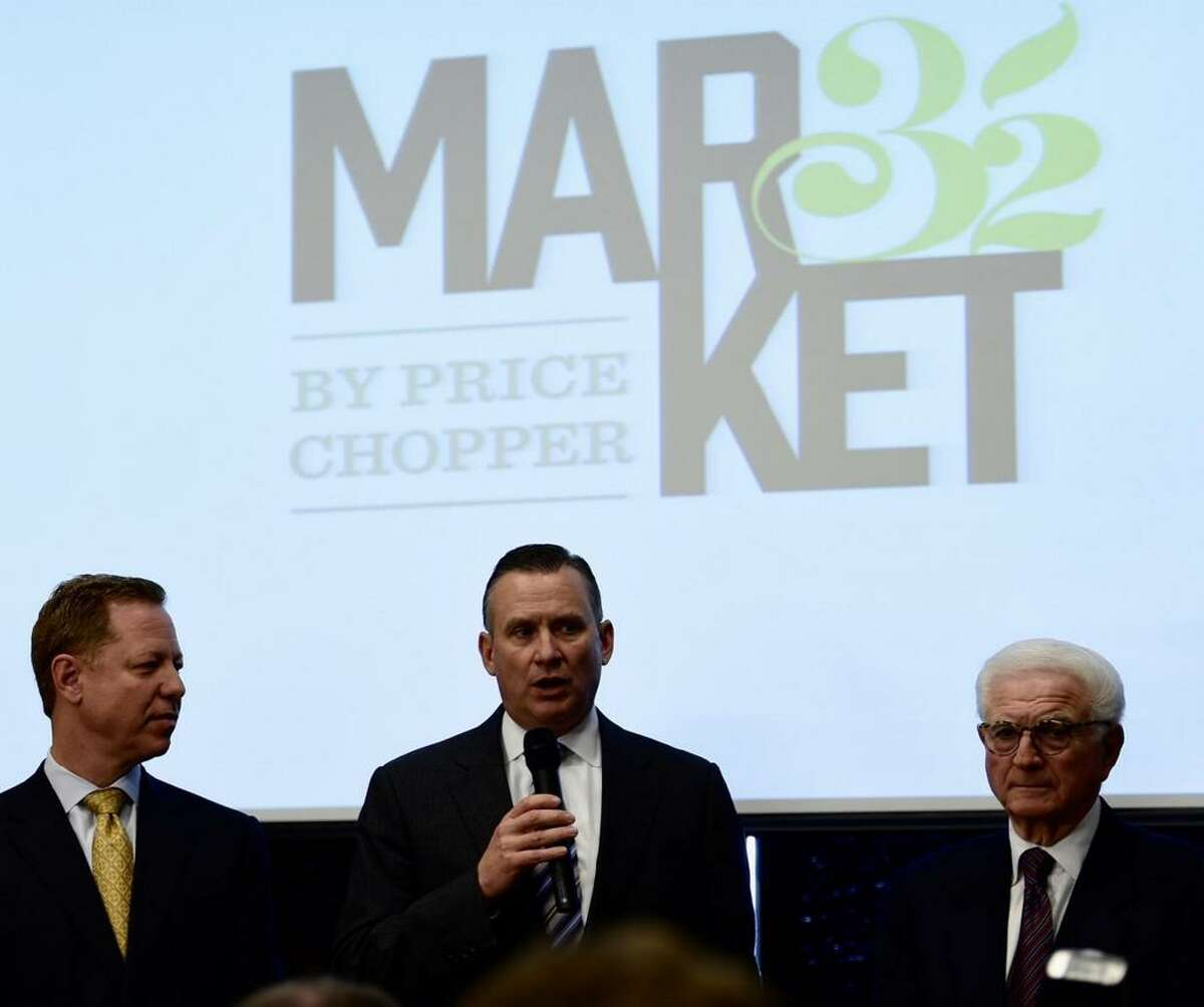 Golub Corp. Chief Operating Officer Scott Grimmett, center, speaks on Nov. 11, 2014, about the new name and direction for Price Chopper, which will become Market 32. Flanking Grimmett are CEO Jerry Golub, left, and Neil Golub, chairman of the board. (Skip Dickstein/Times Union)
