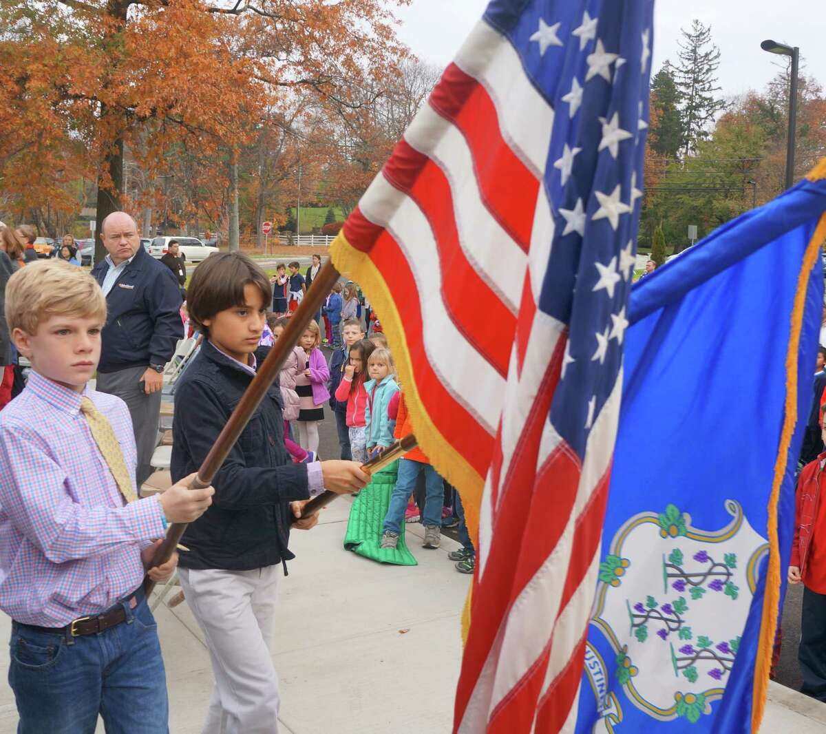 North Street School fifth-graders Trip Williams, left, and Vilas Sogaard-Srikrishnan retire the colors during the Veterans Day ceremony Tuesday at their school.