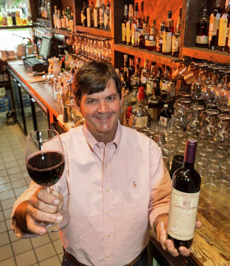 Jeb Stuart, General Manager and Wine Program Director with a bottle of Italian Sanvalentino Umbria Rosso at Coltivare, 3320 White Oak Drive.  Thursday  November 6, 2014 (Craig H. Hartley/For the Chronicle) Photo: Craig Hartley, Freelance / Copyright: Craig H. Hartley