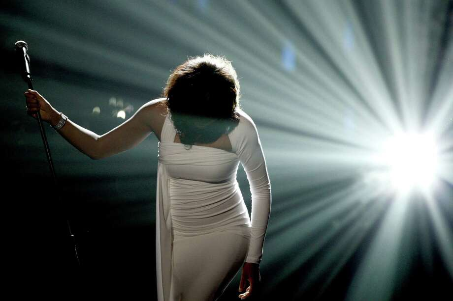 In this Sunday, Nov. 22, 2009, file photo, Artist Whitney Houston performs onstage at the 37th Annual American Music Awards in Los Angeles. Houston died Saturday, Feb. 11, 2012, she was 48. Photo: Matt Sayles, STF / AP2009