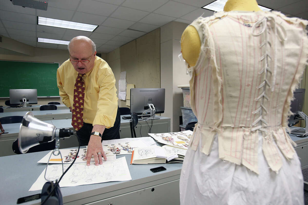 Virgil Johnson works on the costume designs for Trinity University's staging of the play,