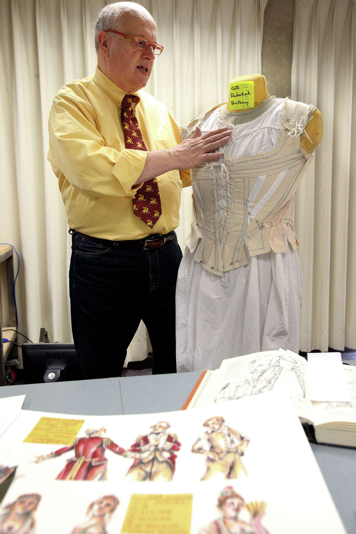 Virgil Johnson. a guest artist at Trinity University, is known for his work with historic costumes.