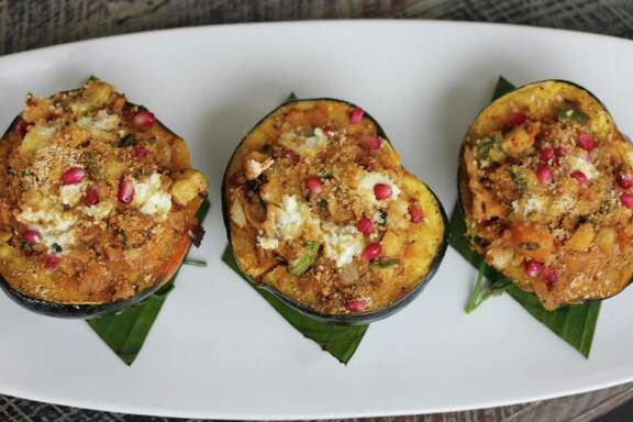 Chorizo-stuffed Acorn Squash with Pomegranate at Caracol restaurant.