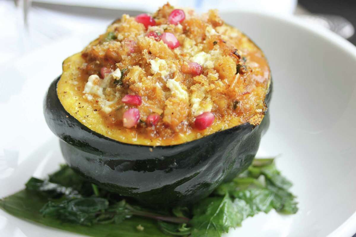Chorizo-stuffed Acorn Squash with Pomegranate at Caracol restaurant.