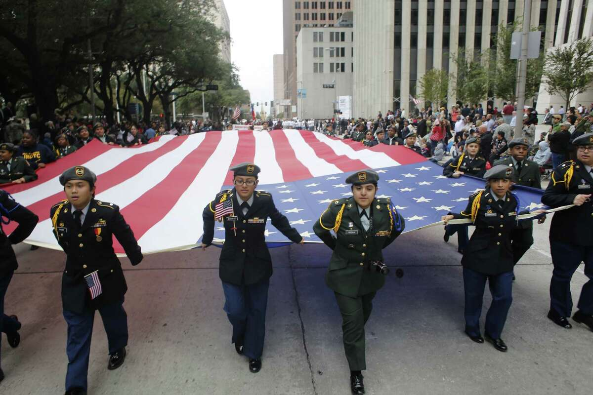 The Veterans Day parade gets underway Tuesday, Nov. 11, 2014, in downtown Houston.