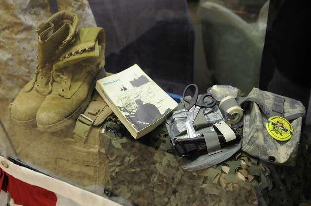 A display is seen behind glass honoring veterans at The College of Saint Rose on Tuesday, Nov. 11, 2014 in Albany, N.Y. (Lori Van Buren / Times Union) Photo: Lori Van Buren / 00028667A