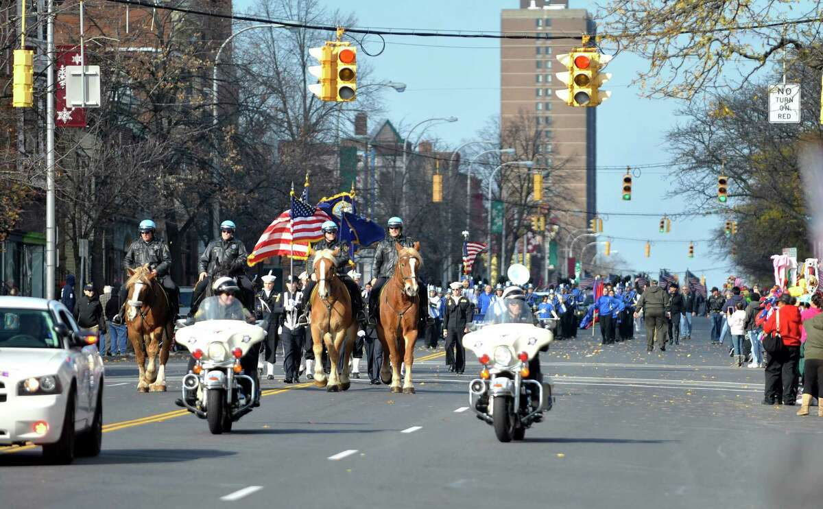 Members of the Albany Police lead the Albany Veterans Day parade down Central Avenue on Tuesday, Nov. 11, 2014, in Albany, N.Y. (Paul Buckowski / Times Union)