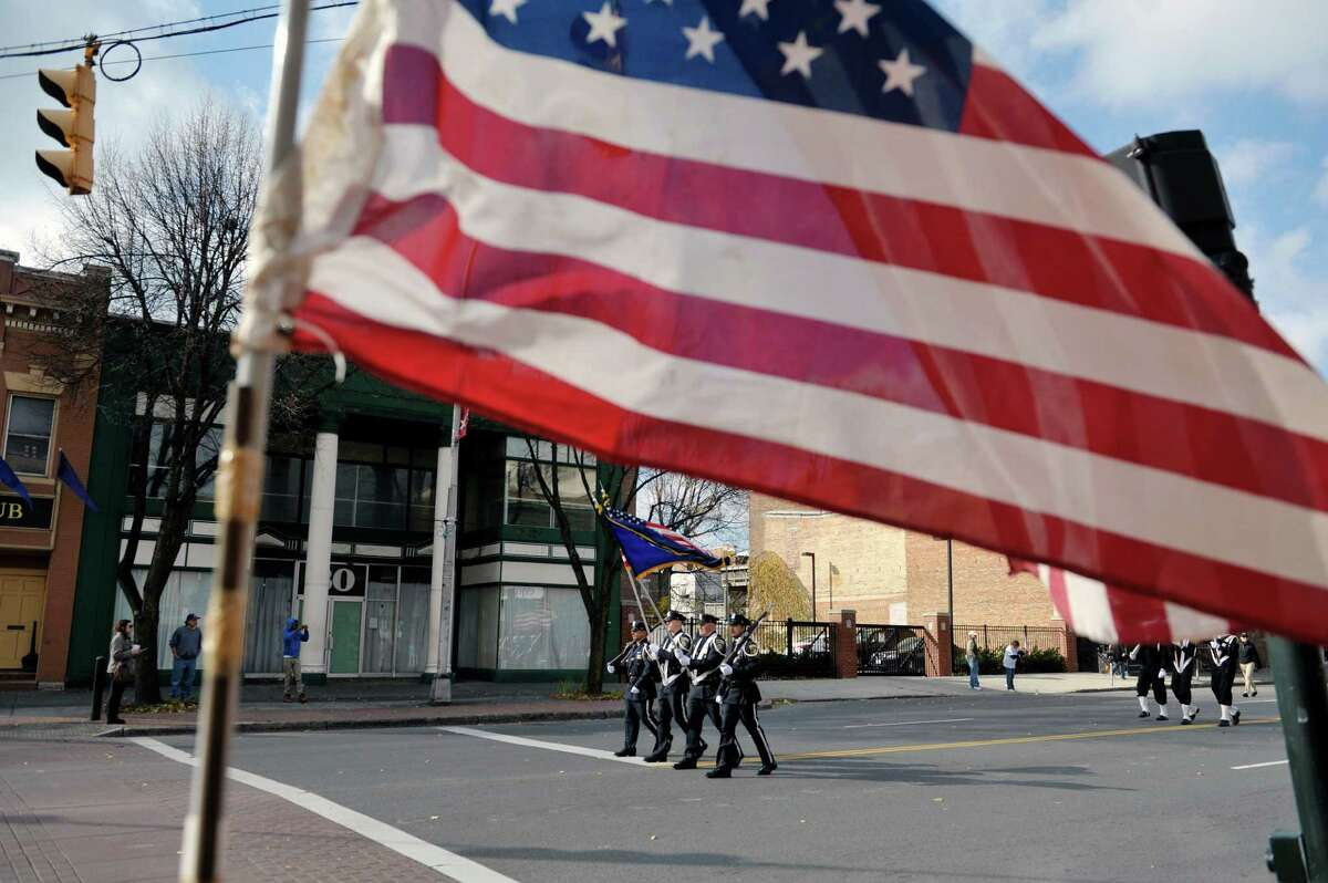 Members of the Albany Police color guard march down Central Avenue as they take part in the Albany Veterans Day parade on Tuesday, Nov. 11, 2014, in Albany, N.Y. (Paul Buckowski / Times Union)