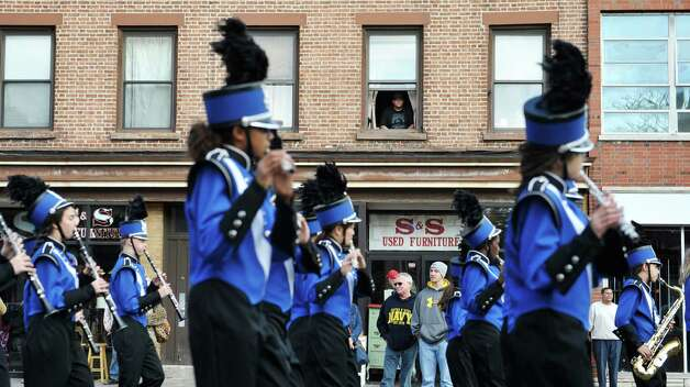 People watch and listen to the Albany Marching Falcons marching band perform as they take part in the Albany Veterans Day parade on Tuesday, Nov. 11, 2014, in Albany, N.Y.   (Paul Buckowski / Times Union) Photo: Paul Buckowski / 00029393A