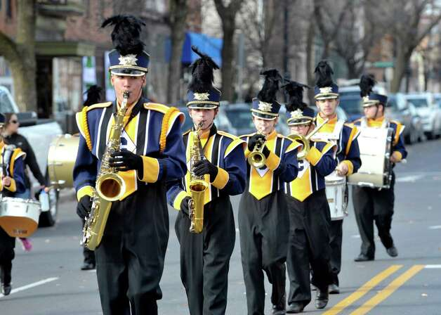 Members of the Cohoes Tigers marching band perform as they march down Central Avenue in the Albany Veterans Day parade on Tuesday, Nov. 11, 2014, in Albany, N.Y.   (Paul Buckowski / Times Union) Photo: Paul Buckowski / 00029393A