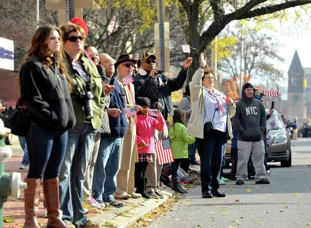 People watch from the side of Washington Avenue as participants march by in the  Albany Veterans Day parade on Tuesday, Nov. 11, 2014, in Albany, N.Y.   (Paul Buckowski / Times Union) Photo: Paul Buckowski / 00029393A