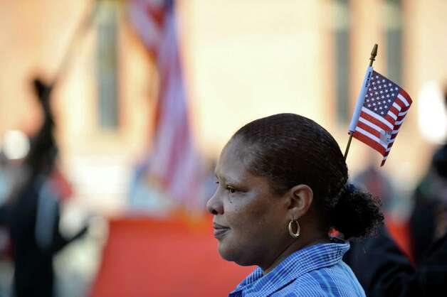 Angela Shephard of Albany watches the Albany Veterans Day parade on Tuesday, Nov. 11, 2014, in Albany, N.Y.   (Paul Buckowski / Times Union) Photo: Paul Buckowski / 00029393A