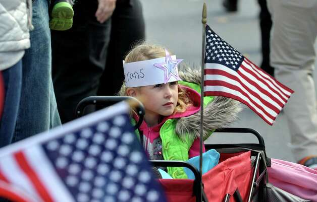 Brooke Casullo, 6, of East Greenbush watches the Albany Veterans Day parade on Tuesday, Nov. 11, 2014, in Albany, N.Y.  Casullo is wearing a headband she made at her school.   (Paul Buckowski / Times Union) Photo: Paul Buckowski / 00029393A