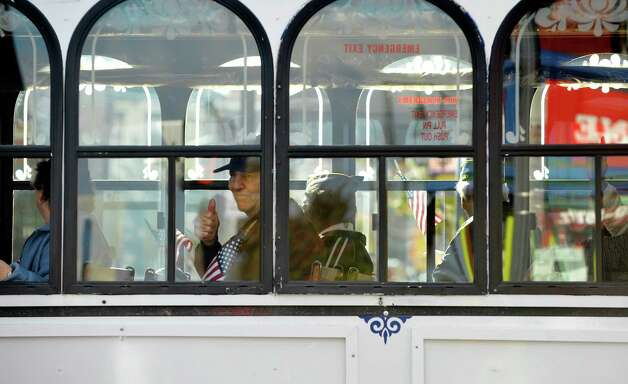 A veteran with the Joseph E. Zaloga American Legion Post #1520 gives a thumbs up as he rides in a trolly in the Albany Veterans Day parade on Tuesday, Nov. 11, 2014, in Albany, N.Y.   (Paul Buckowski / Times Union) Photo: Paul Buckowski / 00029393A