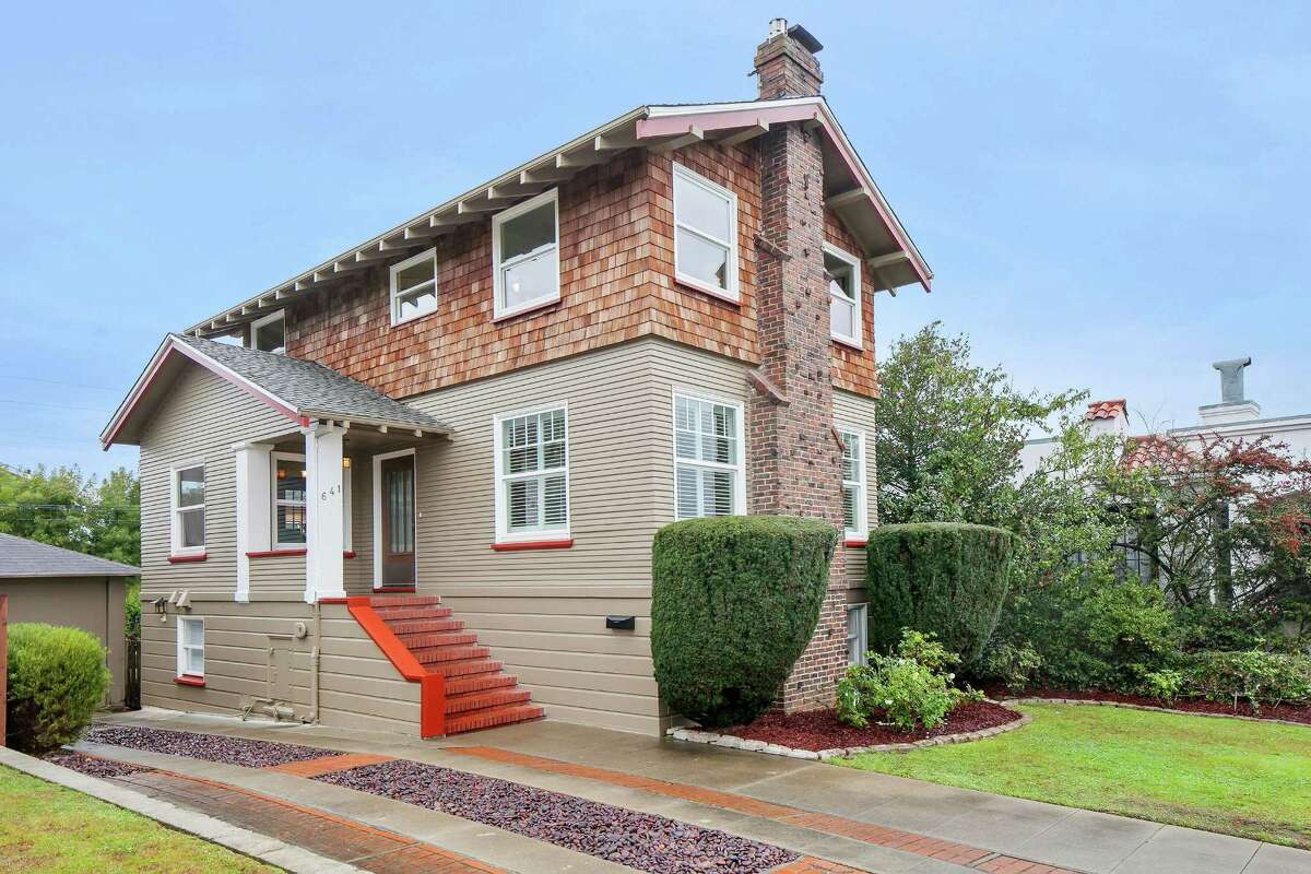 The exterior is a blend of brick, wood shingles and horizontal beams.Click here to search more San Francisco listings »