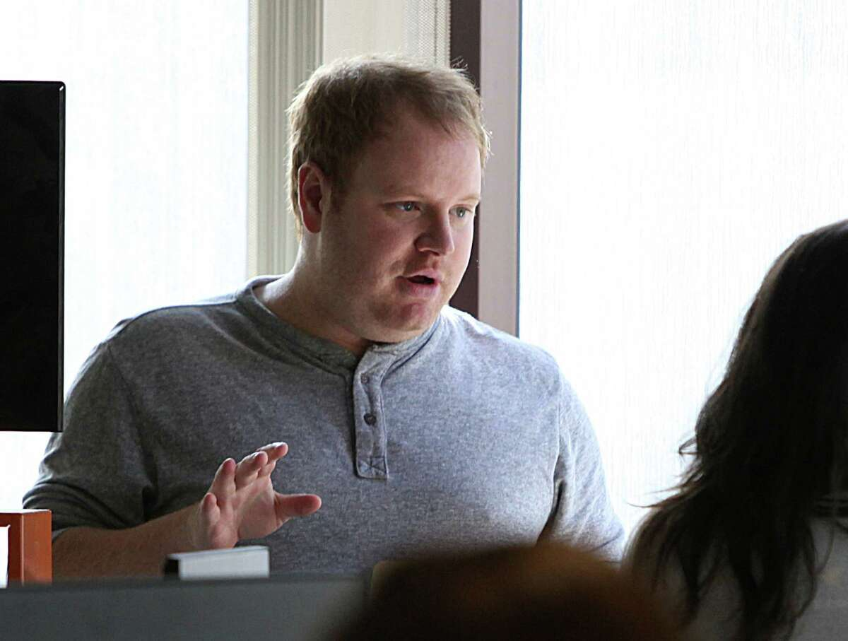 Zenefits CEO Parker Conrad talks with staff in his office in San Francisco.