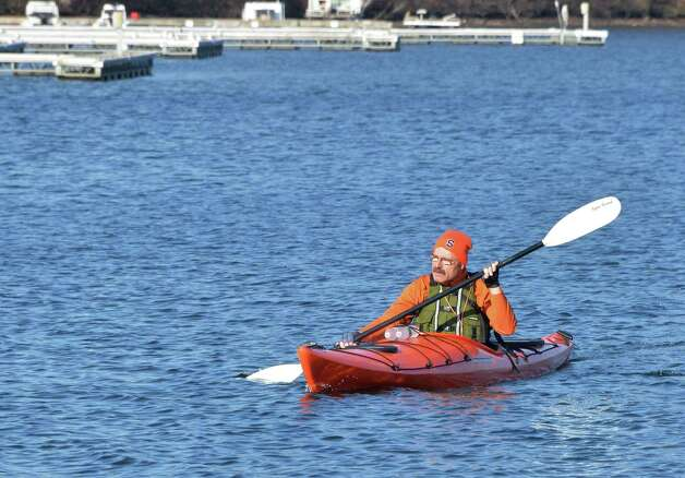 Dan Van Uithuizen of Niskayuna paddles his kayak past empty boat slips on Saratoga Lake Tuesday Nov. 11, 2014, in Saratoga Springs, NY.  (John Carl D'Annibale / Times Union) Photo: John Carl D'Annibale / 00029431A