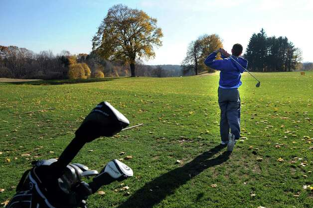 Yoni Israel, 17, of Albany practices on the driving range on Tuesday, Nov. 11, 2014, at Capital Hills Golf Course in Albany, N.Y. Sunday is the last day to shoot the links at this location. (Cindy Schultz / Times Union) Photo: Cindy Schultz / 00029431A