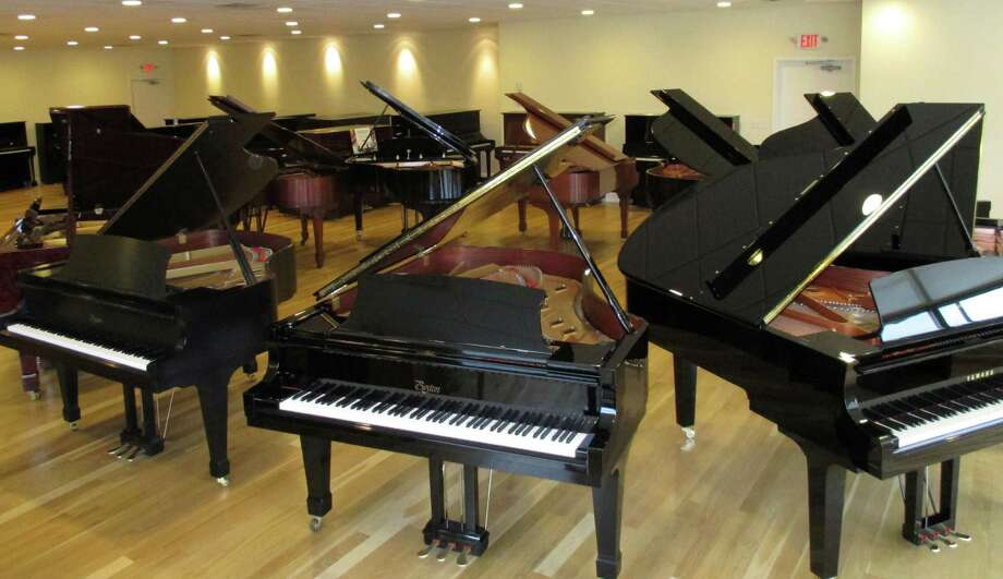 Some of the 85 pianos on display in the Faust Harrison Pianos showroom are arranged in a circle. In addition to the showroom, the 322 Black Rock Turnpike center includes a separate recital area and a room for a new, digital Yahama model that can record and then replay concert performances. Fairfield CT. November 2014. Photo: Fairfield Citizen/Contributed / Fairfield Citizen