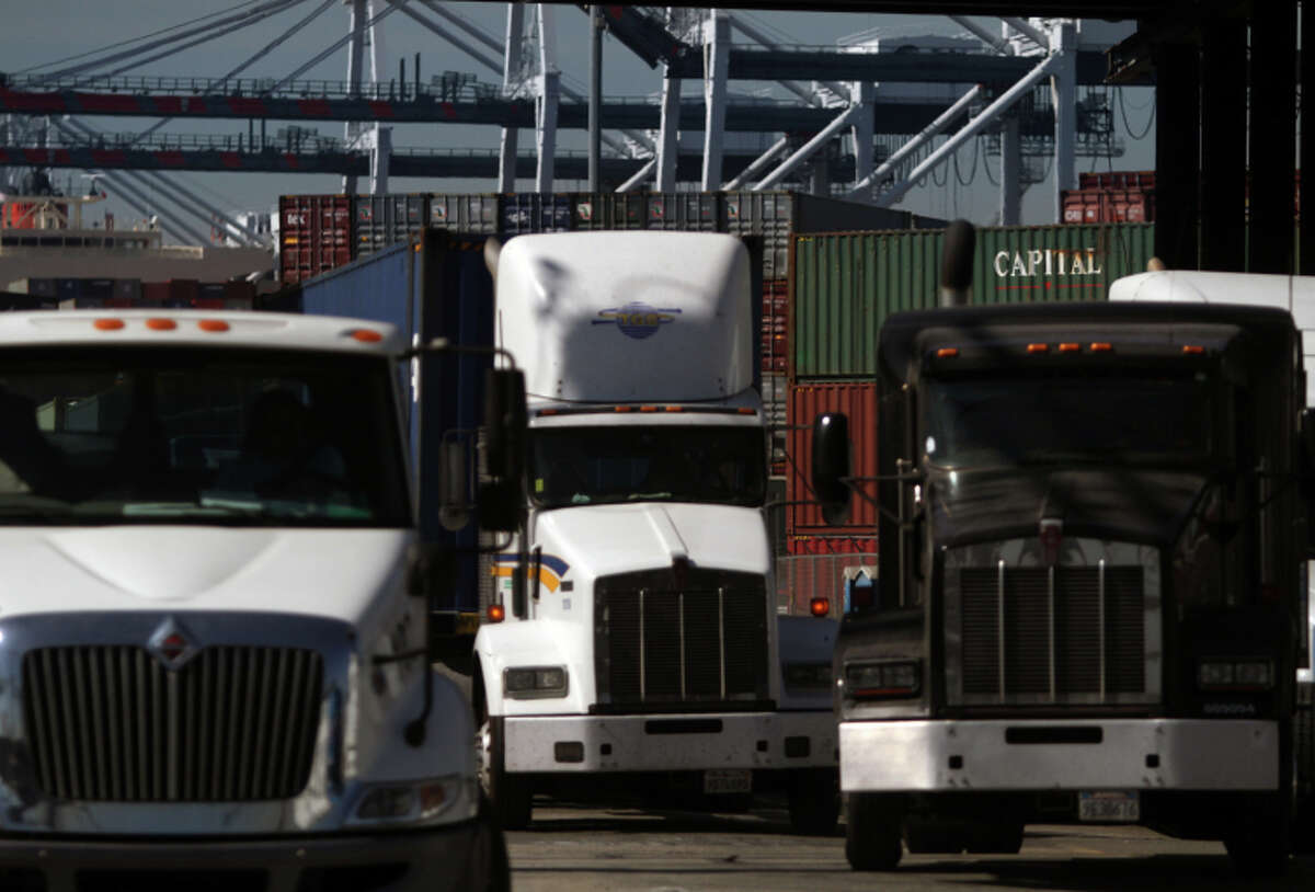 Trucks line up in Wilmington, Calif., at the Port of Los Angeles on Oct. 23, 2014. (Bob Chamberlin/Los Angeles Times/MCT)