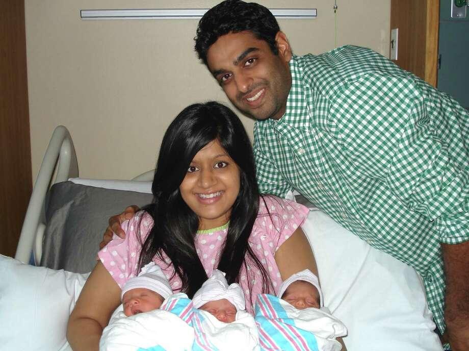 New parents Rina and Atul Jain welcomed triplets Avi, left, Riya and Adi on Oct. 24 at Memorial Hermann Southeast Hospital. Photo: Memorial Hermann Southeast