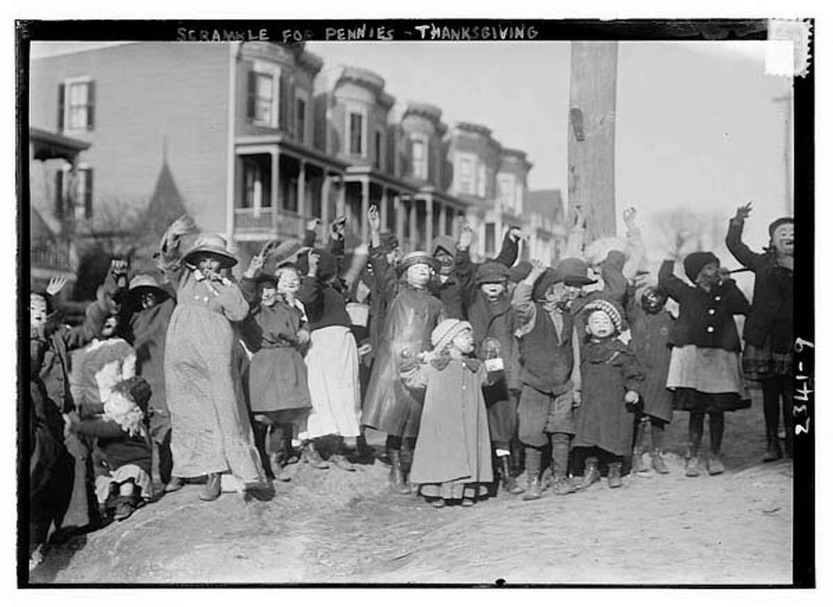Between 1910 and 1915 : Scramble for pennies on Thanksgiving. (Bain News Service)