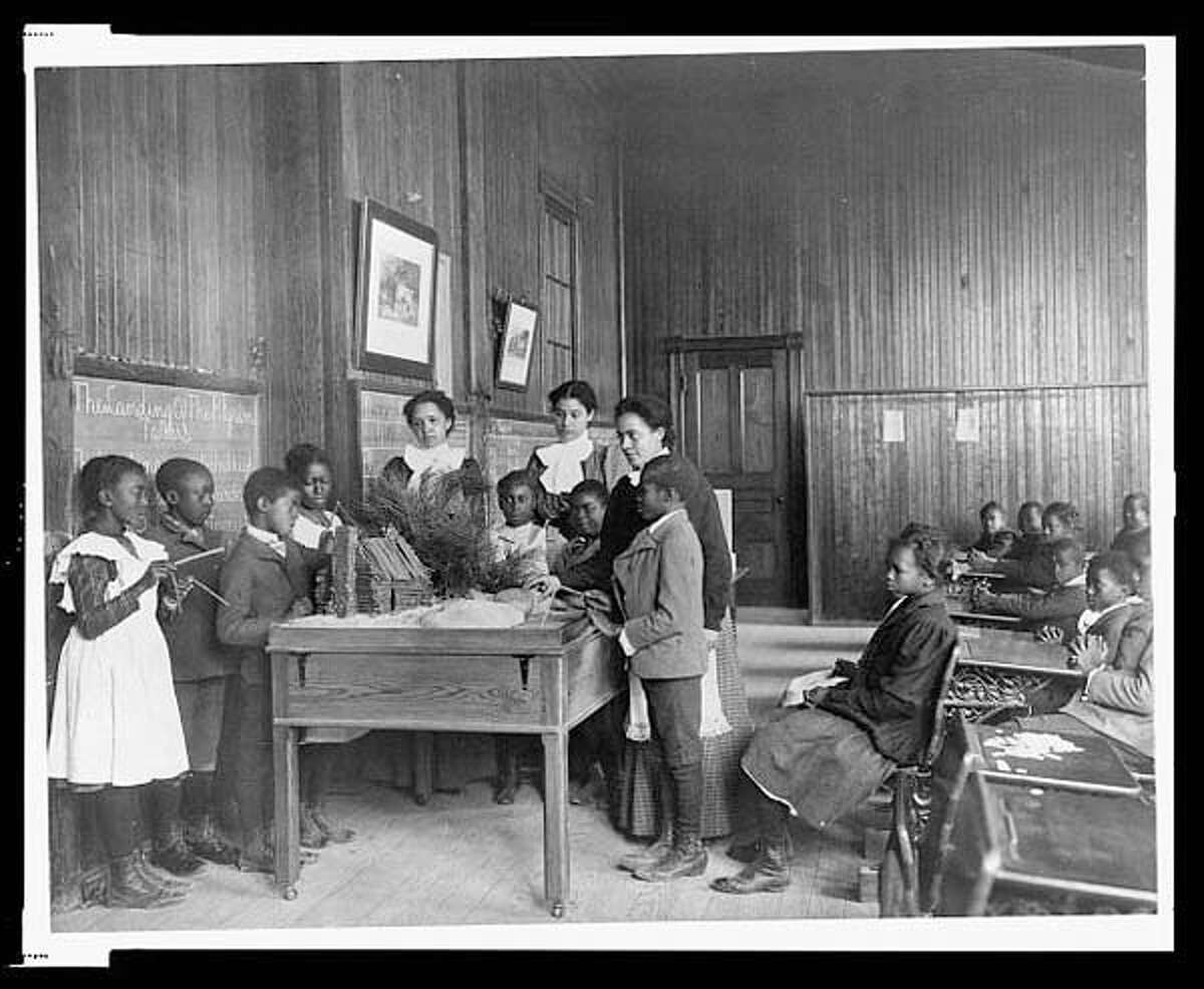 Take a look back at the turkeys of holidays past, plus a strange tradition the American people may have forgotten about, courtesy of the Library of Congress.  1899 or 1900: Children learning about Thanksgiving, with model log cabin on table, Whittier Primary School, Hampton, Virginia. (Frances Benjamin Johnston)