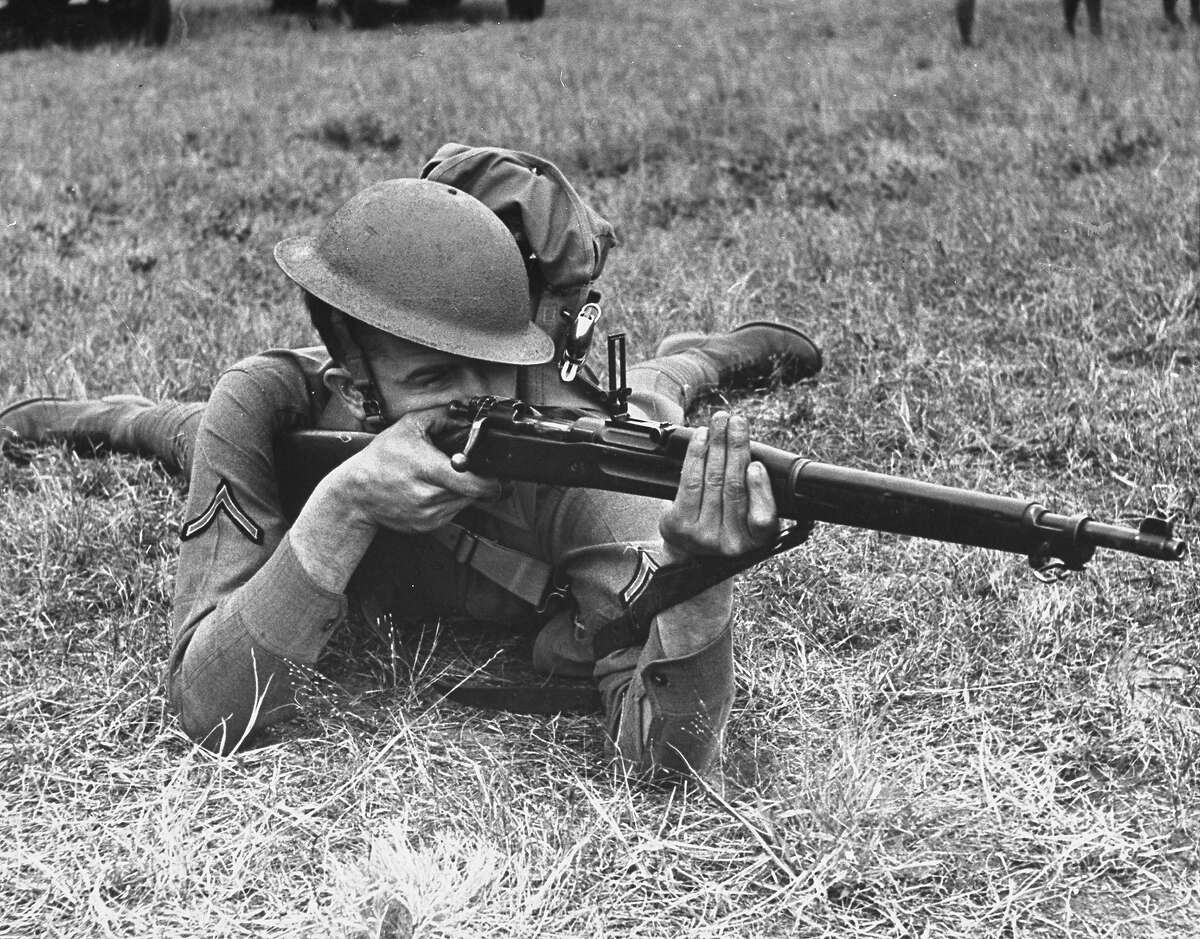 A view of a soldier using a Springfield rifle, 1938.