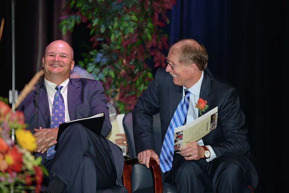Former Cy-Fair ISD superintendent David Anthony, right, enjoys a laugh with current Superintendent Mark Henry during the Anthony Middle School dedication program Nov. 2. Photo: Cfisd