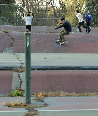 Skateboarders practice their moves at the dilapidated tennis courts in Washington Park on Monday, Nov. 10, 2014 in Albany, N.Y.  (Lori Van Buren / Times Union) Photo: Lori Van Buren / 00029430A