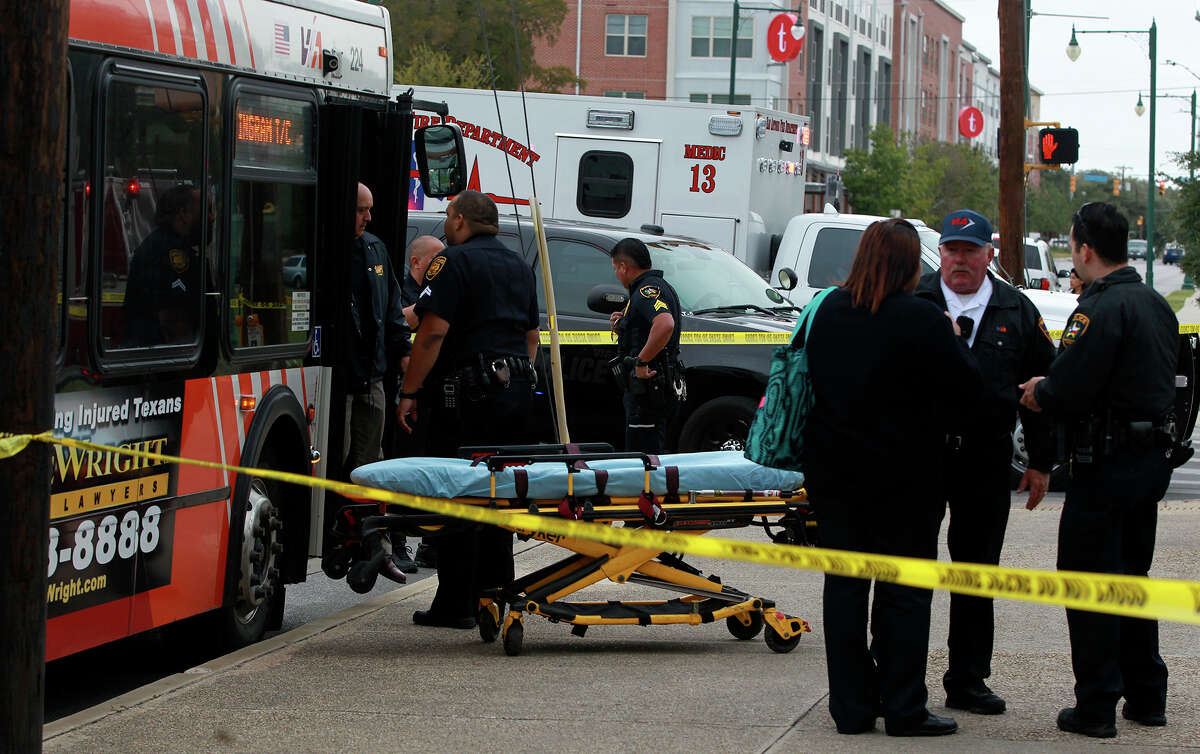 San Antonio police investigate Tuesday November 11, 2014 at the scene of a fatal shooting that took place on a VIA bus at about 2:20 p.m. at Main and Cypress. Sergeant Javier Salazar said a Hispanic male shot another man in his 20s and fled from the bus with a female wearing a pink hoodie.